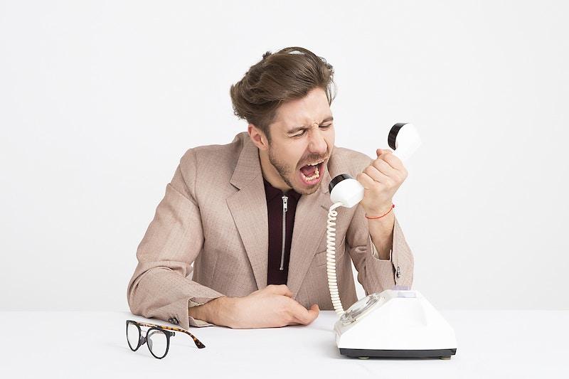 Man-yelling-into-phone